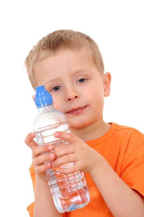 Menino e frasco da água foto de stock
