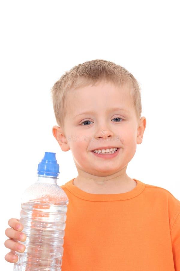 Menino e frasco da água imagens de stock royalty free