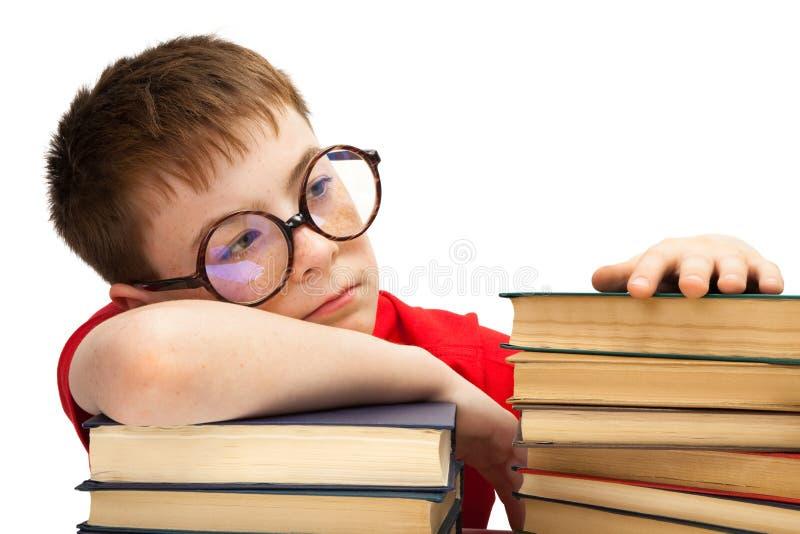 Menino e livros fotos de stock royalty free