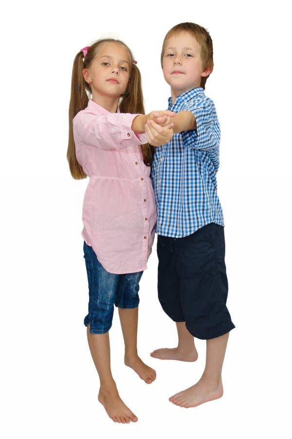 Menino e menina, dança, pose do tango no branco imagem de stock royalty free