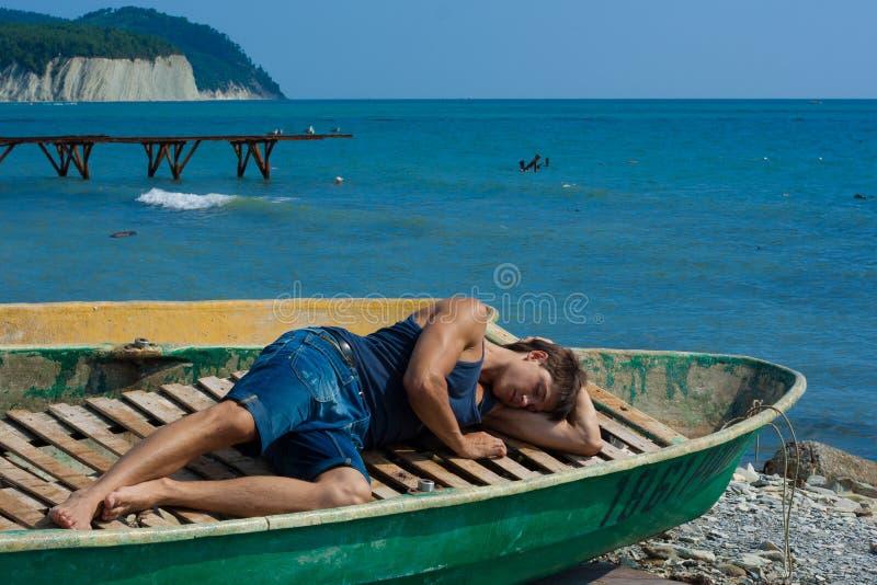 Menino em um barco foto de stock royalty free