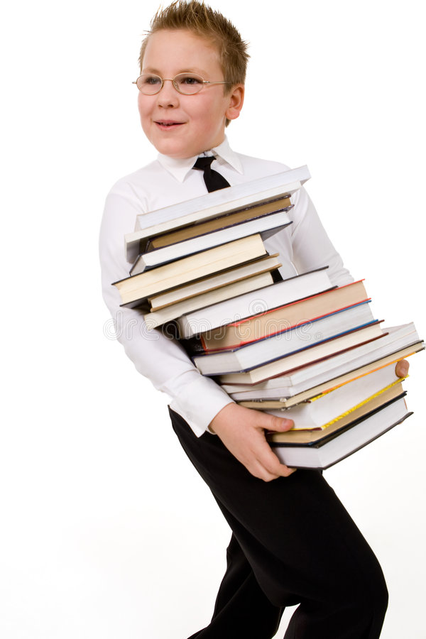 Menino engraçado com livros imagens de stock