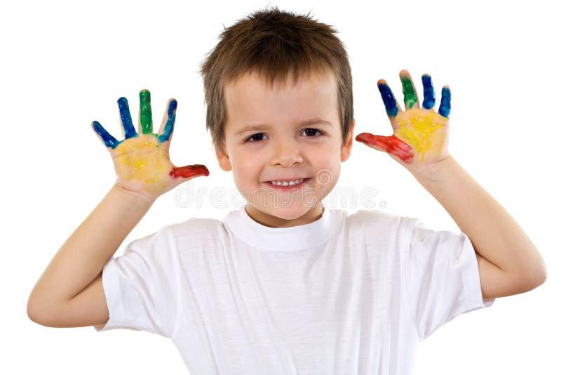 Menino feliz com as mãos pintadas - isoladas imagem de stock