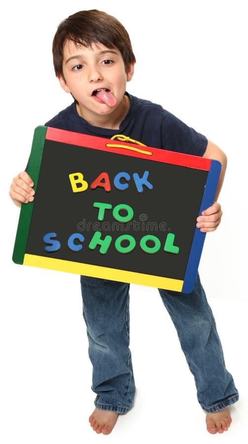 Menino feliz com de volta à escola imagem de stock royalty free
