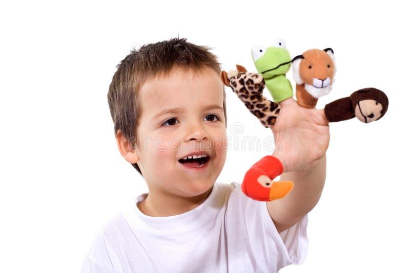 Menino feliz com fantoches do dedo fotos de stock royalty free