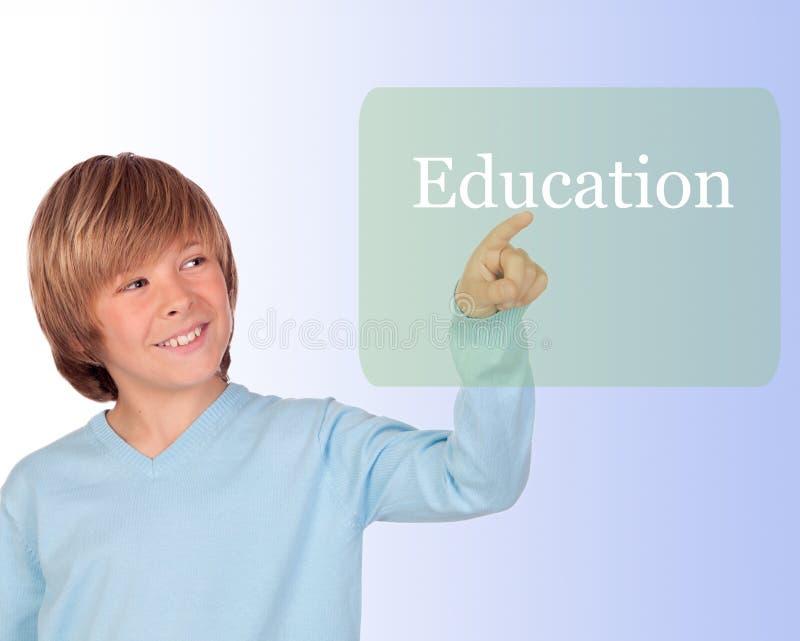 Menino feliz do preteen que aponta a educação da palavra imagens de stock