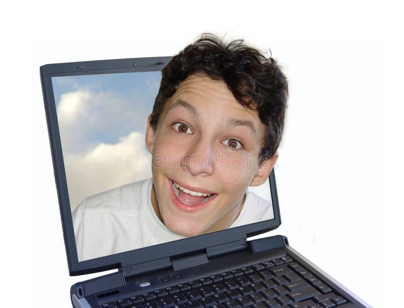 Menino feliz no portátil fotos de stock