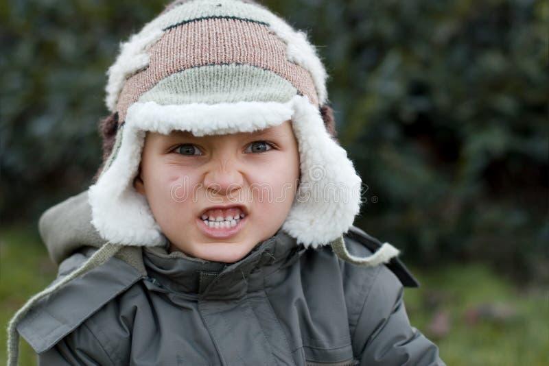 Menino furioso do inverno fotos de stock royalty free