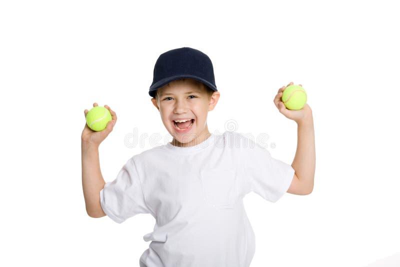 Menino gritando com esferas de tênis fotos de stock