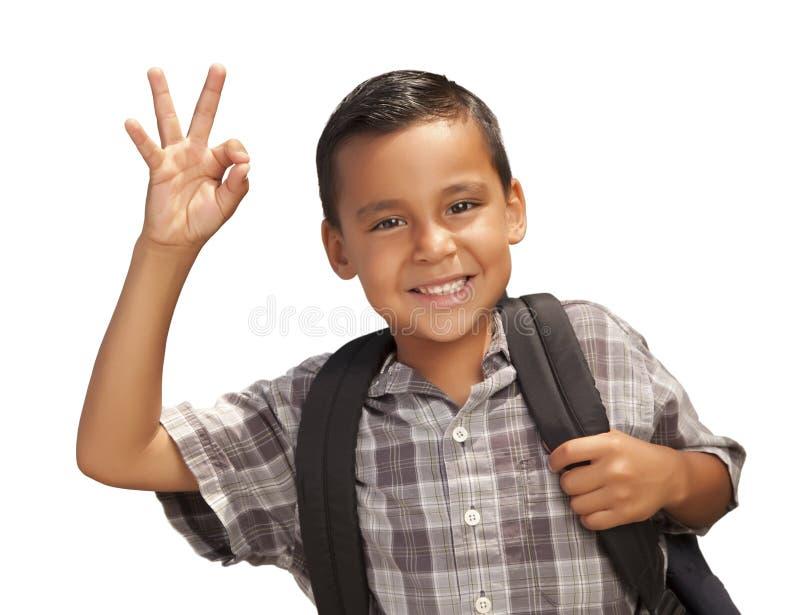 Menino latino-americano novo feliz pronto para a escola no branco foto de stock royalty free