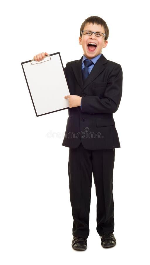 Menino na prancheta da placa da mostra do terno imagem de stock royalty free