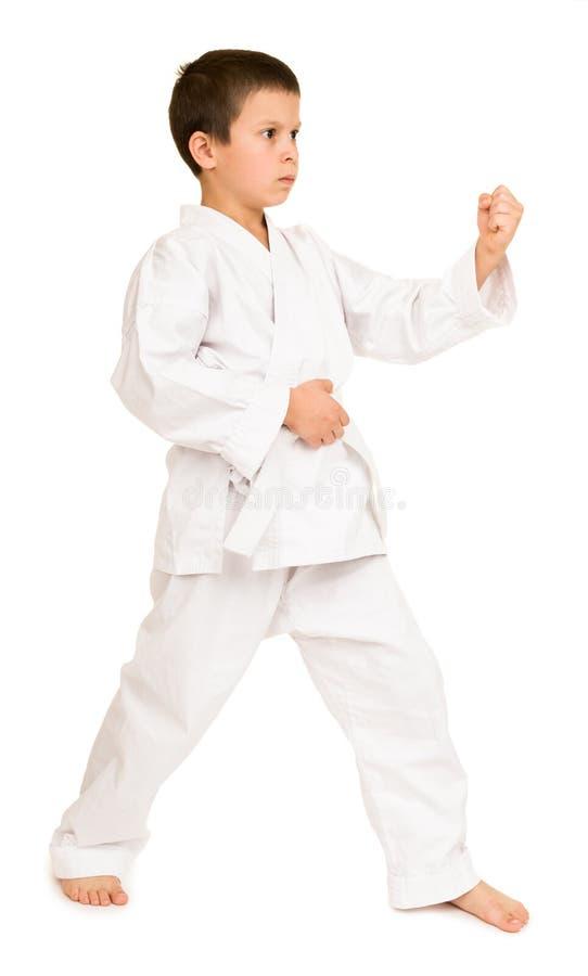 Menino na roupa para artes marciais imagens de stock