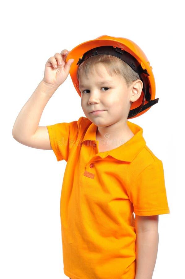 Menino no capacete da construção imagens de stock royalty free