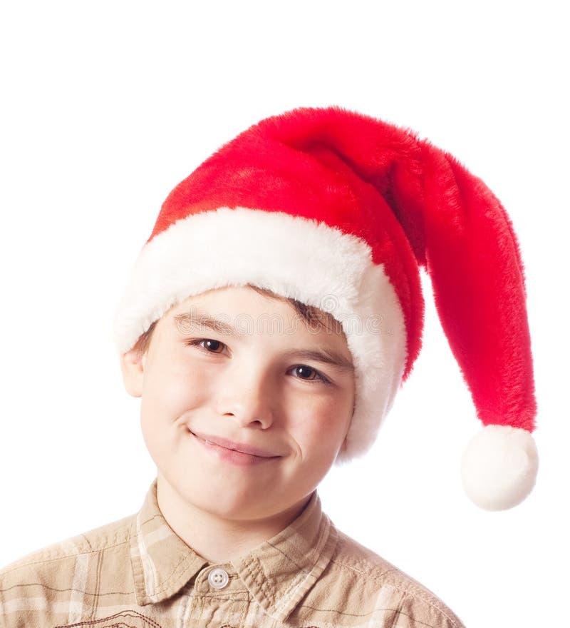 Menino no chapéu de Papai Noel imagem de stock royalty free