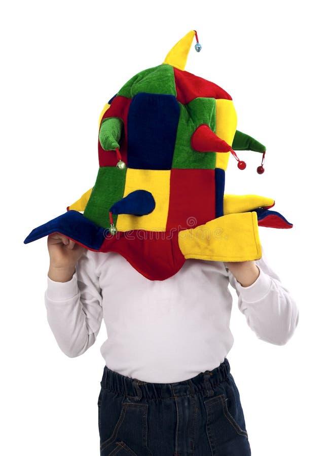 Menino no chapéu do jester imagens de stock