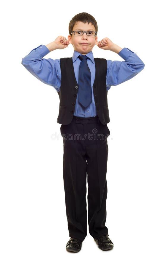 Menino no terno no branco foto de stock