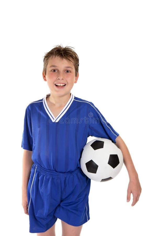Menino no uniforme do futebol fotos de stock royalty free