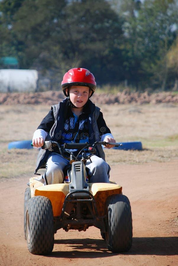 Menino novo em Quadbike fotografia de stock