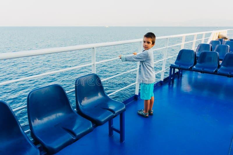 Menino novo em um ferryboat fotos de stock royalty free