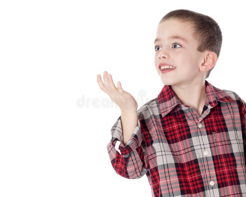 Menino novo na camisa de manta isolada no branco fotografia de stock