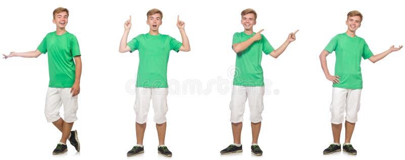 Menino novo no t-shirt verde isolado no branco imagens de stock