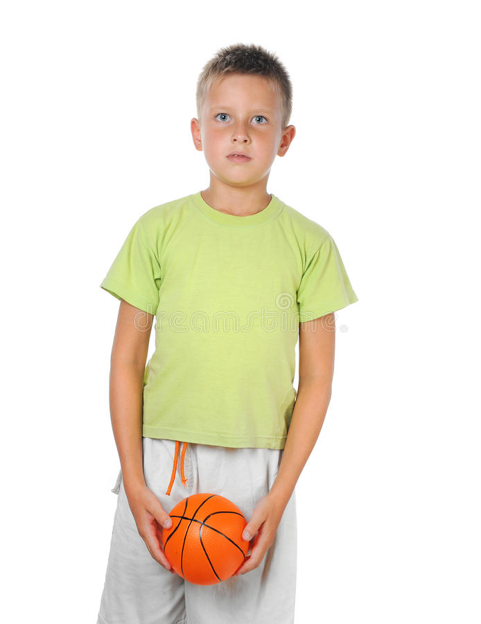 Menino novo que prende um basquetebol imagem de stock royalty free