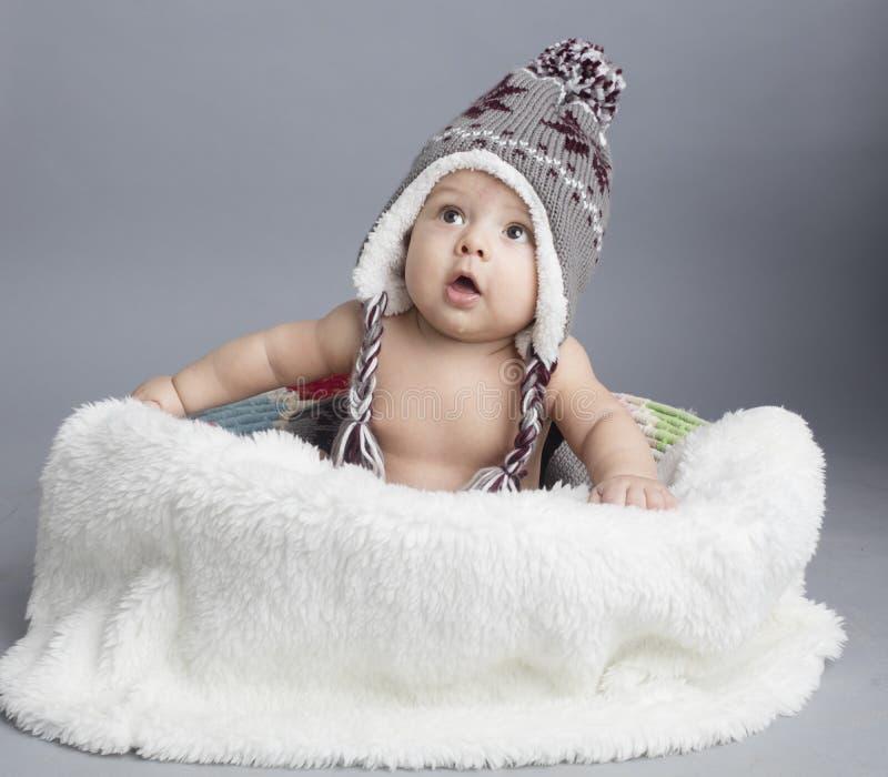 Menino pequeno dentro da pele imagens de stock royalty free