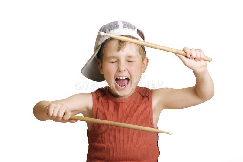 Menino pequeno do baterista foto de stock