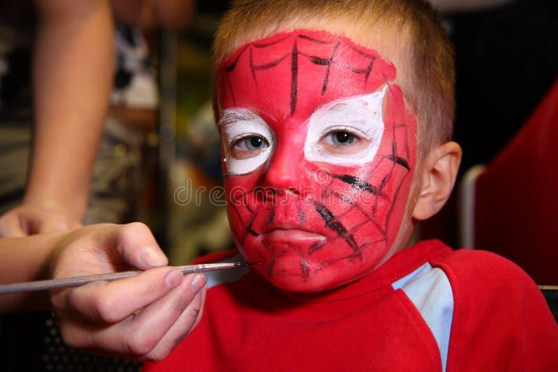 Menino pintado como o spiderman foto de stock