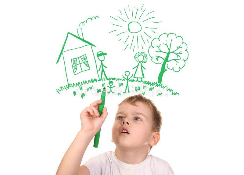 Menino que desenha sua família pela pena felt-tip, colagem imagem de stock