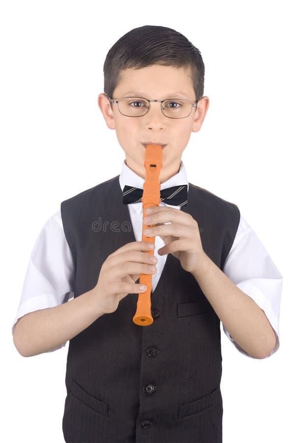 Menino que joga a flauta imagens de stock royalty free