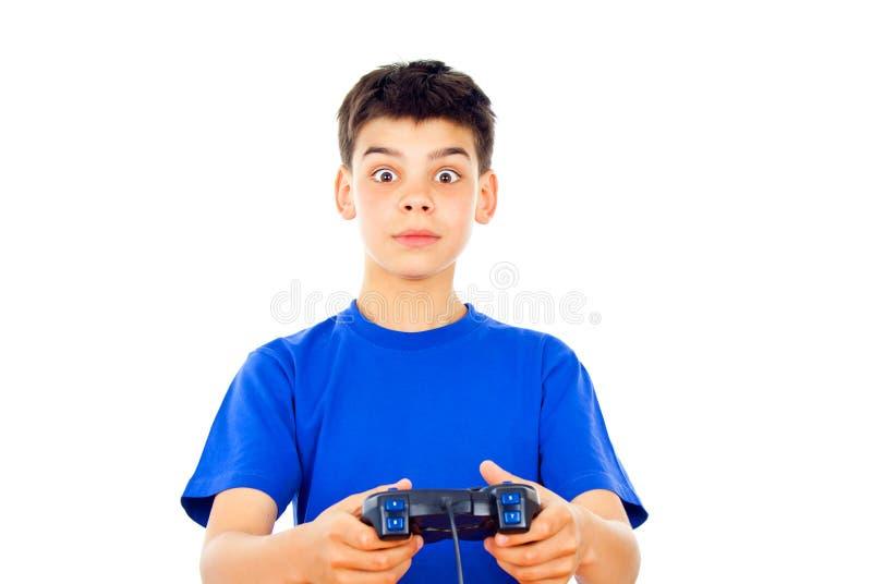 Menino que joga jogos de computador imagem de stock royalty free