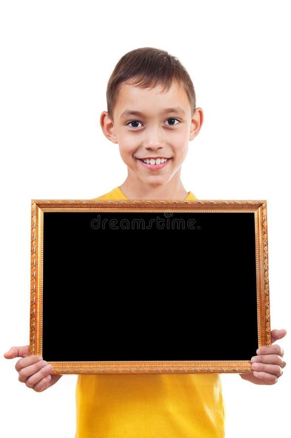 Menino que prende um frame foto de stock