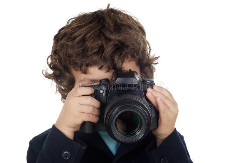 Menino que toma a foto imagem de stock