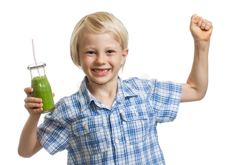 Menino saudável com batido verde foto de stock royalty free