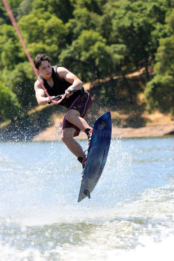 Menino Wakeboarding fotografia de stock royalty free