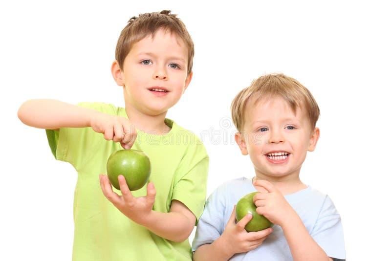 Meninos e maçãs fotografia de stock