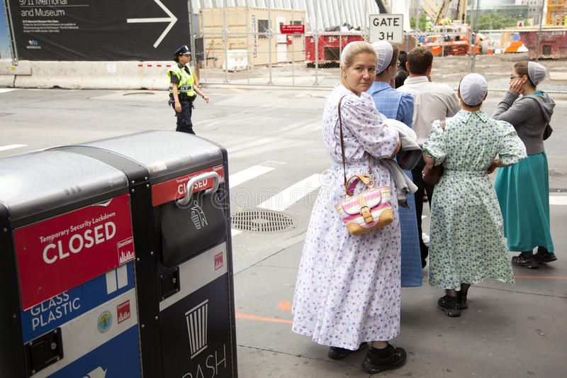 Mennonite girls on pavement in new york city near ground zero royalty free stock photo