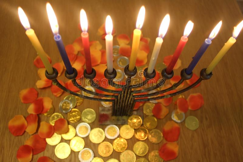 Menorah with candles and chocolate coins Hanukkah and Judaic holiday symbol stock images
