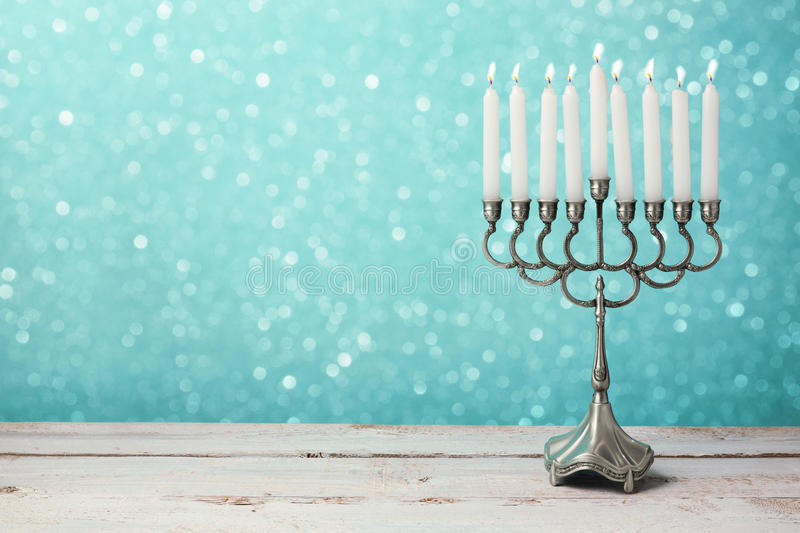 Download Menorah With Candles For Hanukkah Celebration Over Bokeh Background Stock Photo