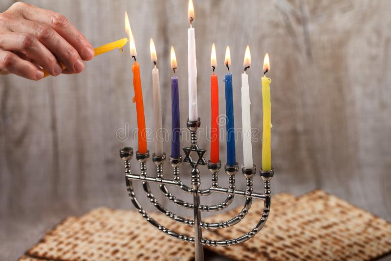 Menorah with candles for Hanukkah on a light wooden background stock image