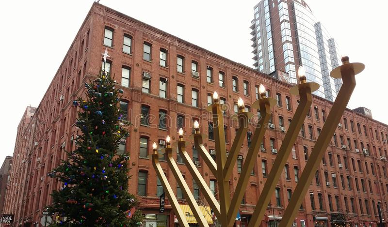 Menorah and Christmas Tree, Brooklyn, New York City, NY, USA. A Christmas tree and a menorah are displayed side by side near Anchorage Place, Pearl Street, and stock photos