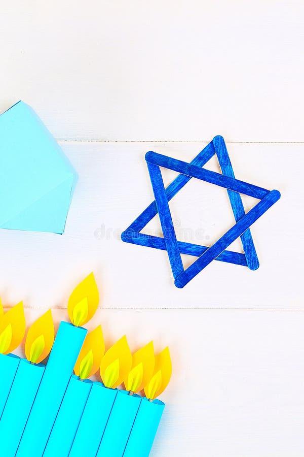 Menorah, dreidel, sevivon, the star of David. DIY for a child. Celebration of Chanukah stock photography