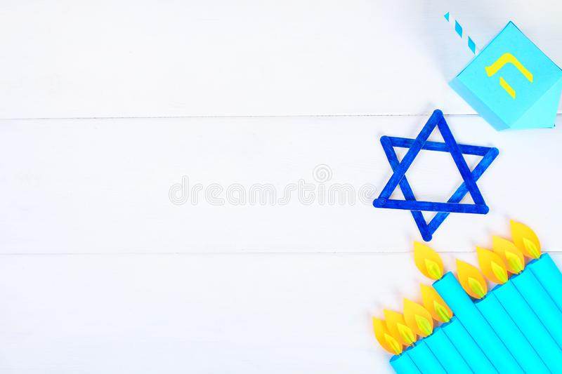 Menorah, dreidel, sevivon, the star of David with their own hands on a white wooden table. DIY for a child. Celebration of Chanuka stock images