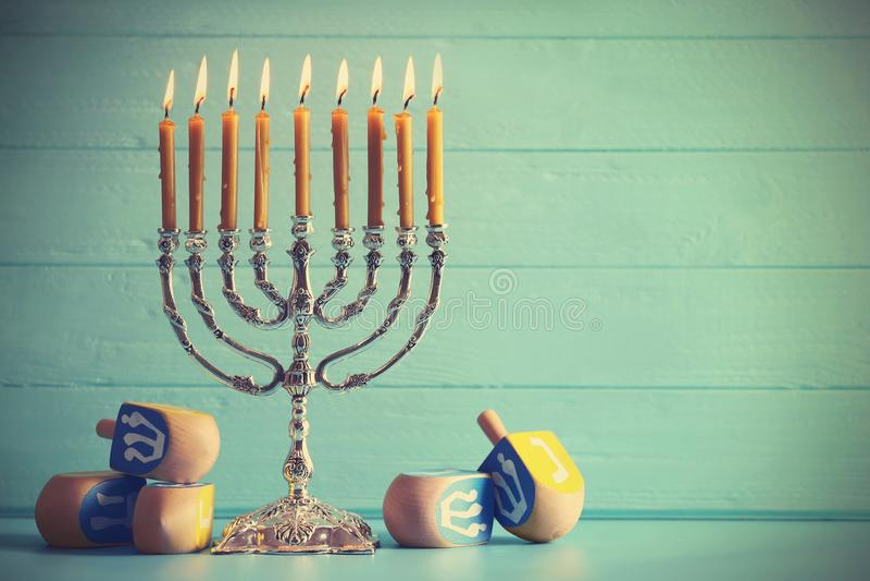 Menorah with dreidels for Hanukkah on table royalty free stock photos