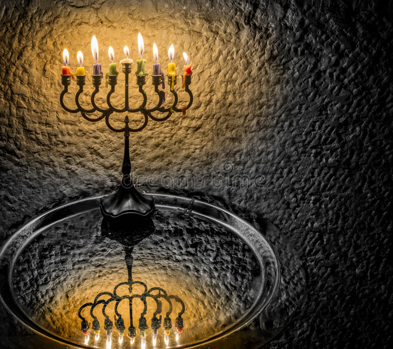 Menorah is Hanukkah Jewish holiday symbol. Image of menorah with glittering candles for Jewish Hanukkah holiday. Toned for inspiration retro style and solemn royalty free stock photo