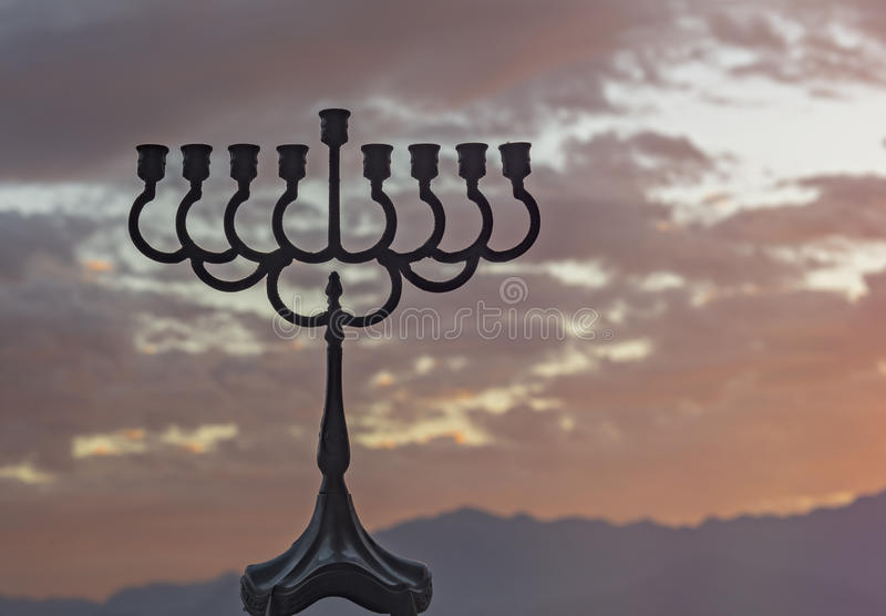 Menorah is a major traditional Jewish symbol for Hanukkah holiday. Low key image slightly toned for inspiration of retro style and feast ceremony. Selective stock image