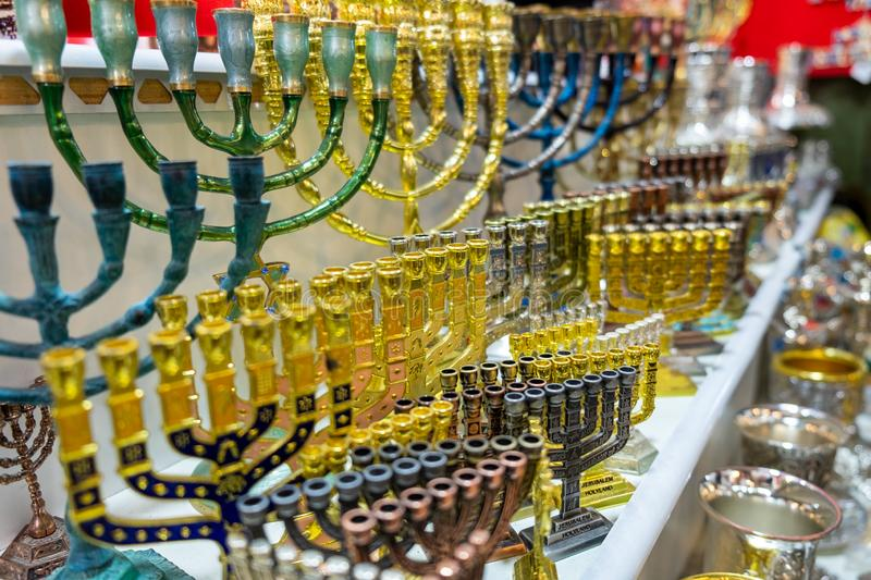 Menorah, a seven-lamp candelabrum used in contemporary Jewish temples, for sale at old market. Jerusalem. Israel stock photos