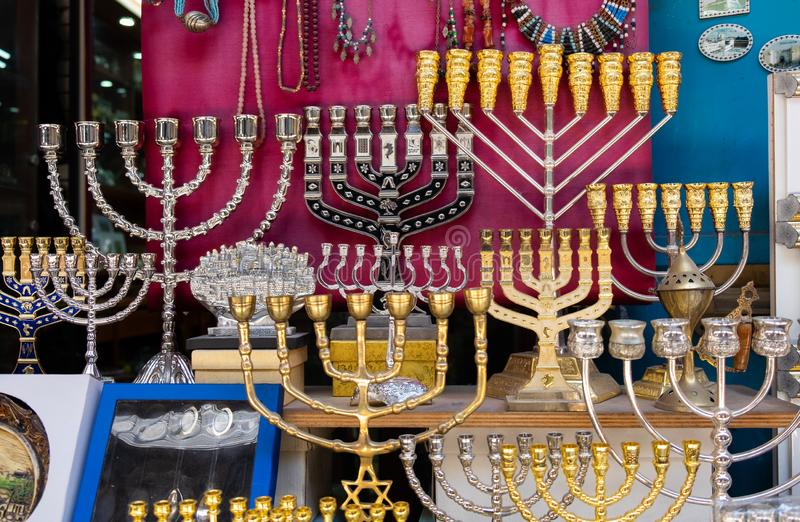 Menorah, a seven-lamp candelabrum used in contemporary Jewish temples, for sale at old market. Jerusalem. Israel stock photo