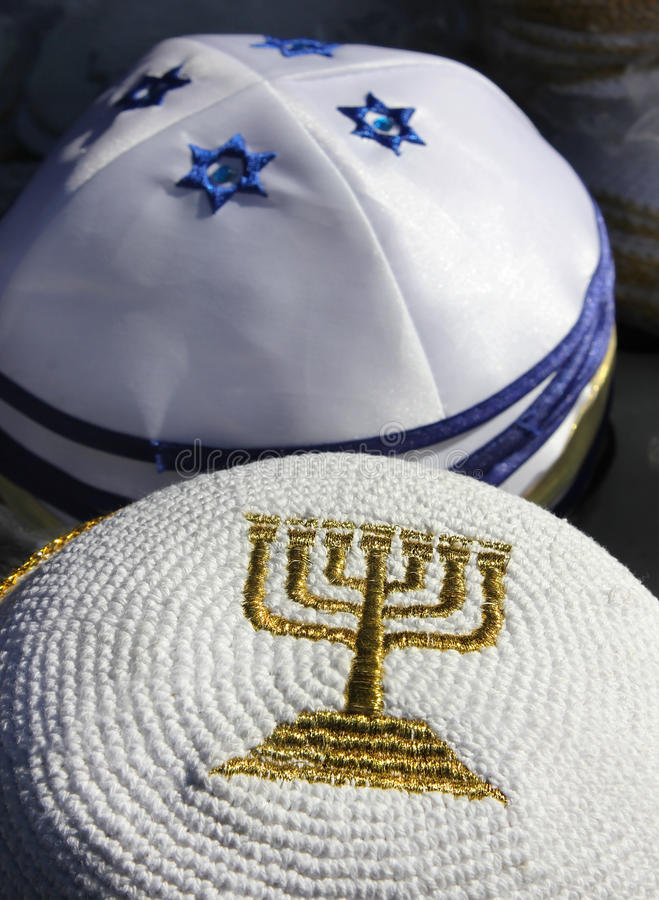 Menorah - a symbol of Hanukkah. Embroidered with gold thread on Jewish religious cap royalty free stock photos
